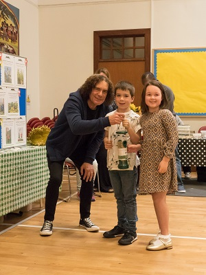 Ron presenting St Joseph's pupils with a bird feeder for sunflower seeds